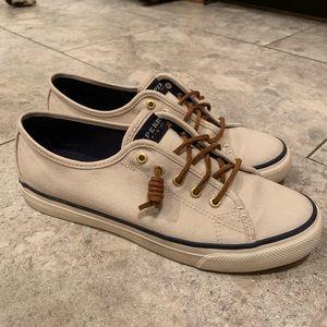 Tan Sperry slip on sneakers